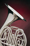 French horn Silver Isolated On Red Stock Photo