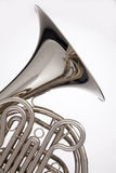French Horn Silver Isolated On White. A professional silver French horn isolated against a white background in the vertical format Stock Photo