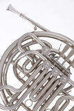 French horn Silver Isolated on White. A professional silver French  horn isolated against a white background Stock Image