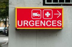 French hospital emergency entry sign with text in fre. Closeup of french hospital emergency entry sign with text in french urgences stock photos