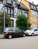 French house in Alsace with two parked cars in front Stock Photos
