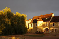 French house and tree at sunset Stock Photo