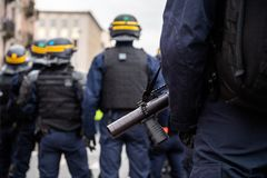 Police officers securing the zone in front of Yellow Jackets Gil. French ice officers securing the zone in front of the yellow vests movement protesters on gas royalty free stock photos