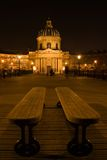 The French Institute. Le pont des Arts by night with the French Institute in the background - Paris, France stock photography