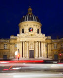 French Institute in Paris. The Institut de France, or French Institute, across from the Pont des Arts on the Seine river in Paris. The institute is an stock photography