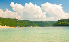 French Jura. Tourism in the French Jura region. Tourists on a beach along the river Ain, surrounded by forests, on a beautiful sunny day stock images