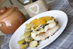 French kitchen: meat under cheese with potato Royalty Free Stock Images