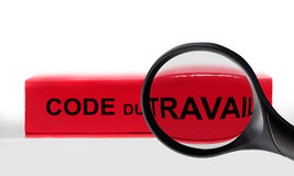 French labor code book and magnifying glass, labor code law reform in France concept Stock Photo