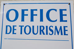 French language. Office de Tourisme  hanged sign in France Stock Photography