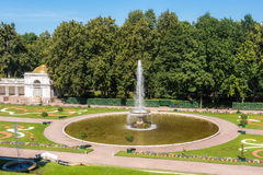 French large fountain in Peterhof. View from the terrace of the Grand Palace to the French large fountain in the Central Part of The Lower Park in the Peterhof Royalty Free Stock Images