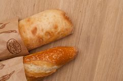 French loaf and Italian ciabatta with golden crust, top view royalty free stock photos