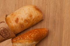 French loaf and Italian ciabatta with golden crust royalty free stock photography