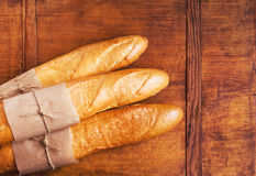 French loaves on rustic wooden table. Assortment of baked French baguettes on a wooden table stock images
