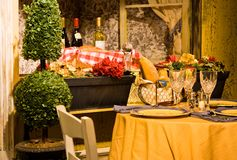 French Lunch. A cozy and rustic French style lunch/dinner table in front of a window with bottles of wine. Typical bistro royalty free stock image