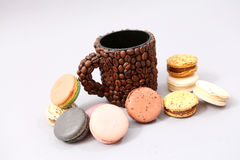 French macaron and a coffee benas mug Royalty Free Stock Images