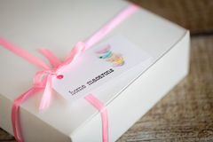French macarons in a box. With pink ribbon Stock Photos