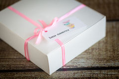 French macarons in a box. With pink ribbon Stock Image