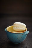French macarons with buttercream filling in bowl Stock Images