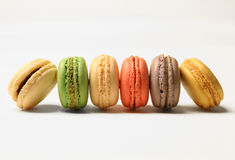 French macarons. Colorful assortment of French macarons on white background Stock Image