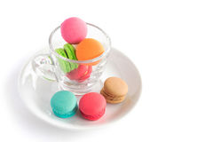 French macarons colorful on glass cup with white background Stock Photo