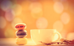 French macarons and cup of coffee Royalty Free Stock Images