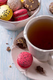 French Macarons with cup of tea Stock Images