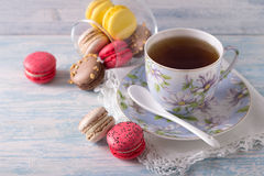 French Macarons with cup of tea Royalty Free Stock Photo