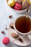 French Macarons with cup of tea Royalty Free Stock Photography