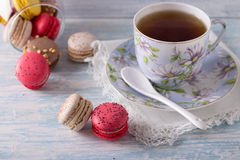 French Macarons with cup of tea Stock Photography