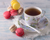 French Macarons with cup of tea Royalty Free Stock Photos