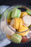 French macarons in glass bowls Royalty Free Stock Images
