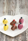 French Macarons. Meringue. Cookies and cream Macaron. French meringues are truly Hard To Resist Delicacies. Variety of flavors. Sandwich-like cookies, made with Royalty Free Stock Image