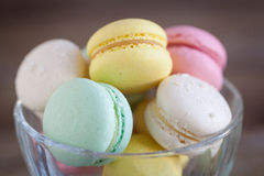 French macarons, mix colors. In a glass bowl Stock Photo