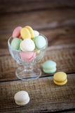 French macarons, mix colors. In a glass bowl Stock Image