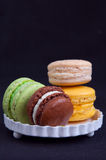 French macarons on plate Stock Images