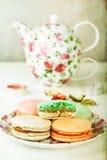 French Macarons and tea set Royalty Free Stock Photos