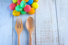 French macarons toys and wooden fork with spoon Stock Images