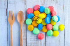 French macarons toys with wooden fork and spoon Stock Photo