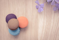 French macarons on wooden background Royalty Free Stock Image