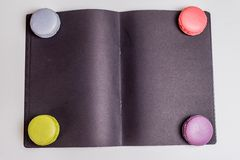 French Macaronsons on black Paper Royalty Free Stock Image