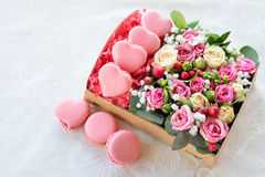 French macaroon heart-shaped Valentine's Day, the box with flowe Royalty Free Stock Images