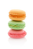 French macaroons. A stack of three different French macaroons on white background royalty free stock photos