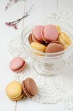 French macaroons. In a bowl on the white table Royalty Free Stock Photos