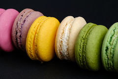 French macaroons with black background Stock Photo
