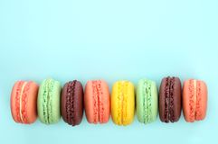 French macaroons on blue background Stock Photos