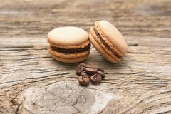 French macaroons with coffee beans. Royalty Free Stock Photography