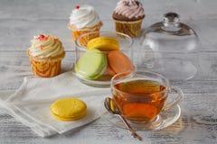 French macaroons. Coffee, chocolate, vanilla and raspberry Stock Photos