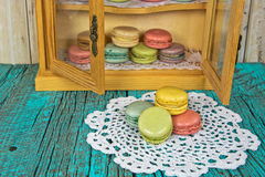 French macaroons in cupboard Stock Photo