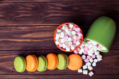 French macaroons and marshmellow in dark colors Royalty Free Stock Photos
