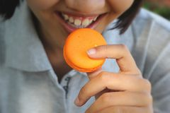 French macaroons orange tasty snacks. Royalty Free Stock Photography